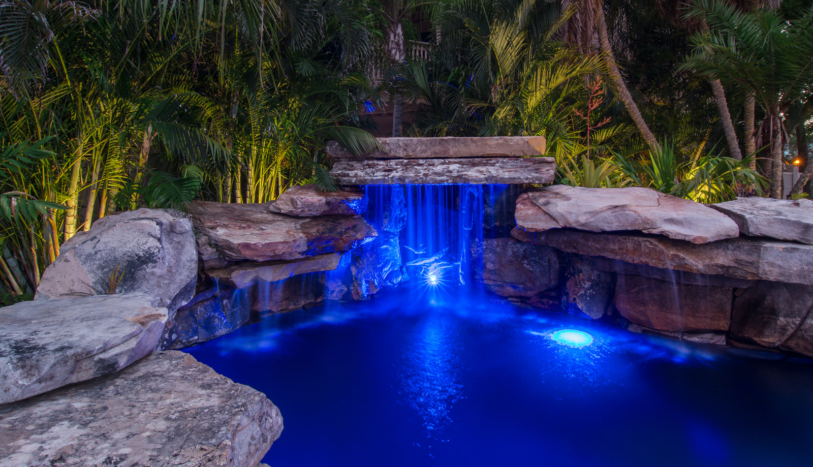 Swimming with the fishes lucas lagoons for Koi pool design