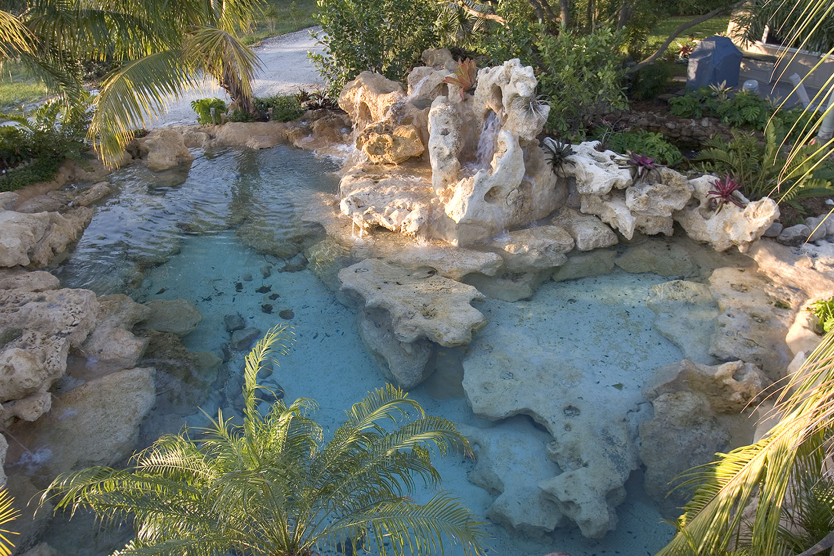 Natural limestone blue lagoon lucas lagoons for Natural rock swimming pools
