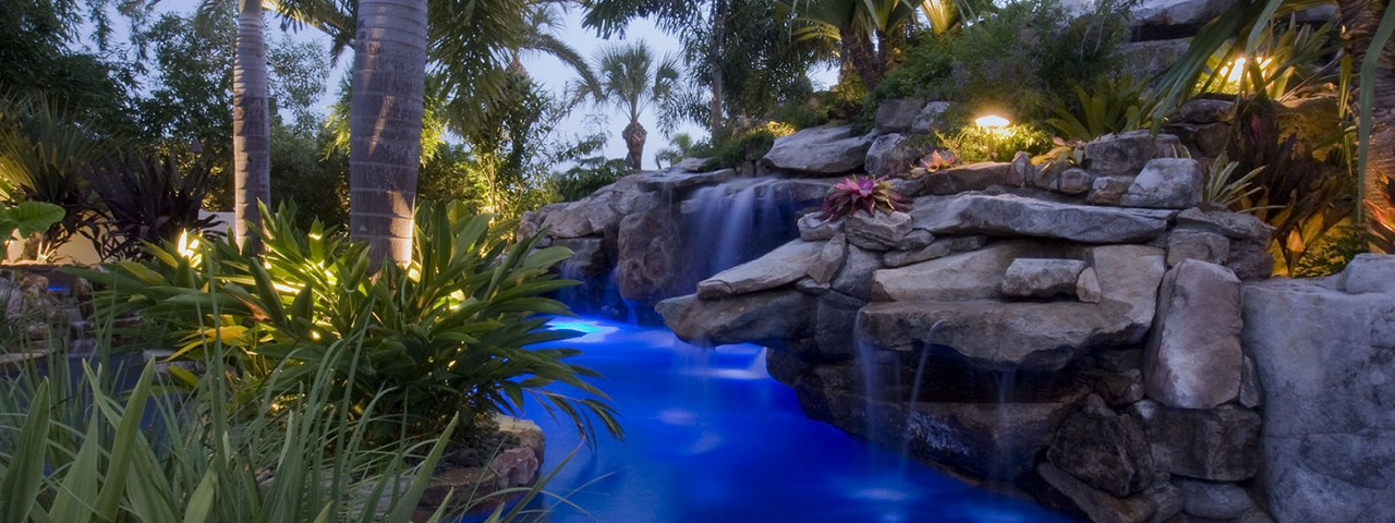 Lagoon Pool with Slide, Island Planters, Large Grotto and Spa