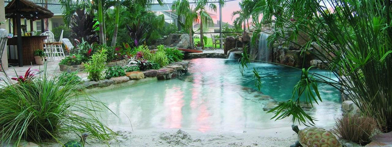 Lagoon Pool with Sand Bottom Entrance and Bridge