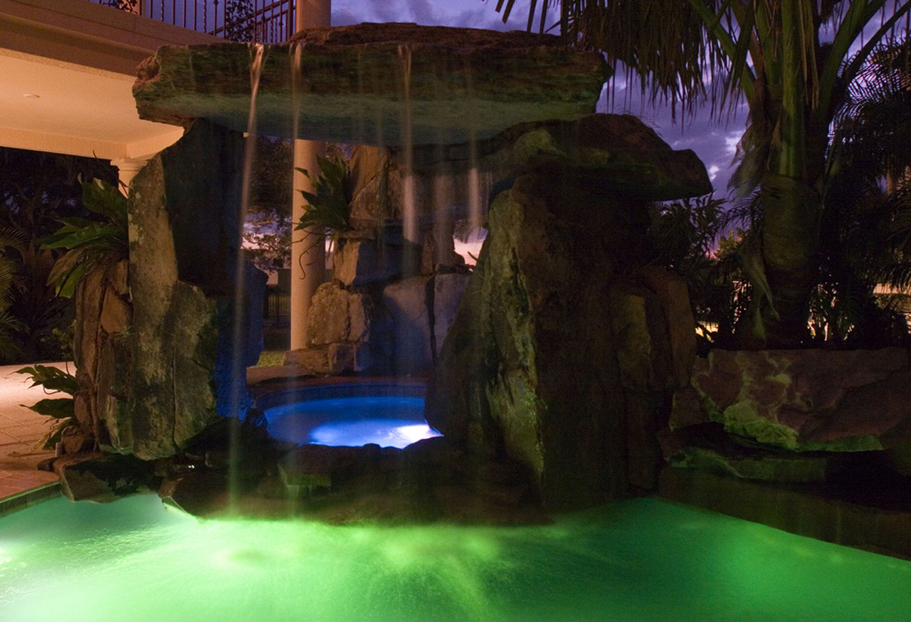 lagoon pool with tall grotto and natural stone waterfall - Swimming Pools With Grottos