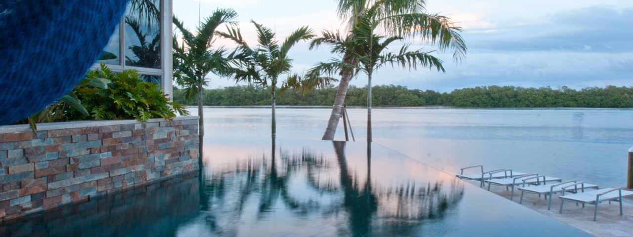 infinity-edge-pool-palm-trees-hammock-bay