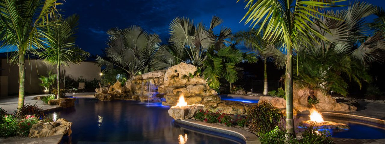 Natural lagoon pool Rock Waterfalls Stone Fire Pits and Natural Grotto