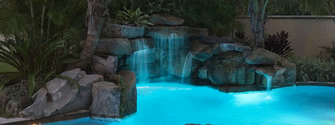 Image of Lagoon Pool with Spa, Grotto Waterfall, and Fire Pit