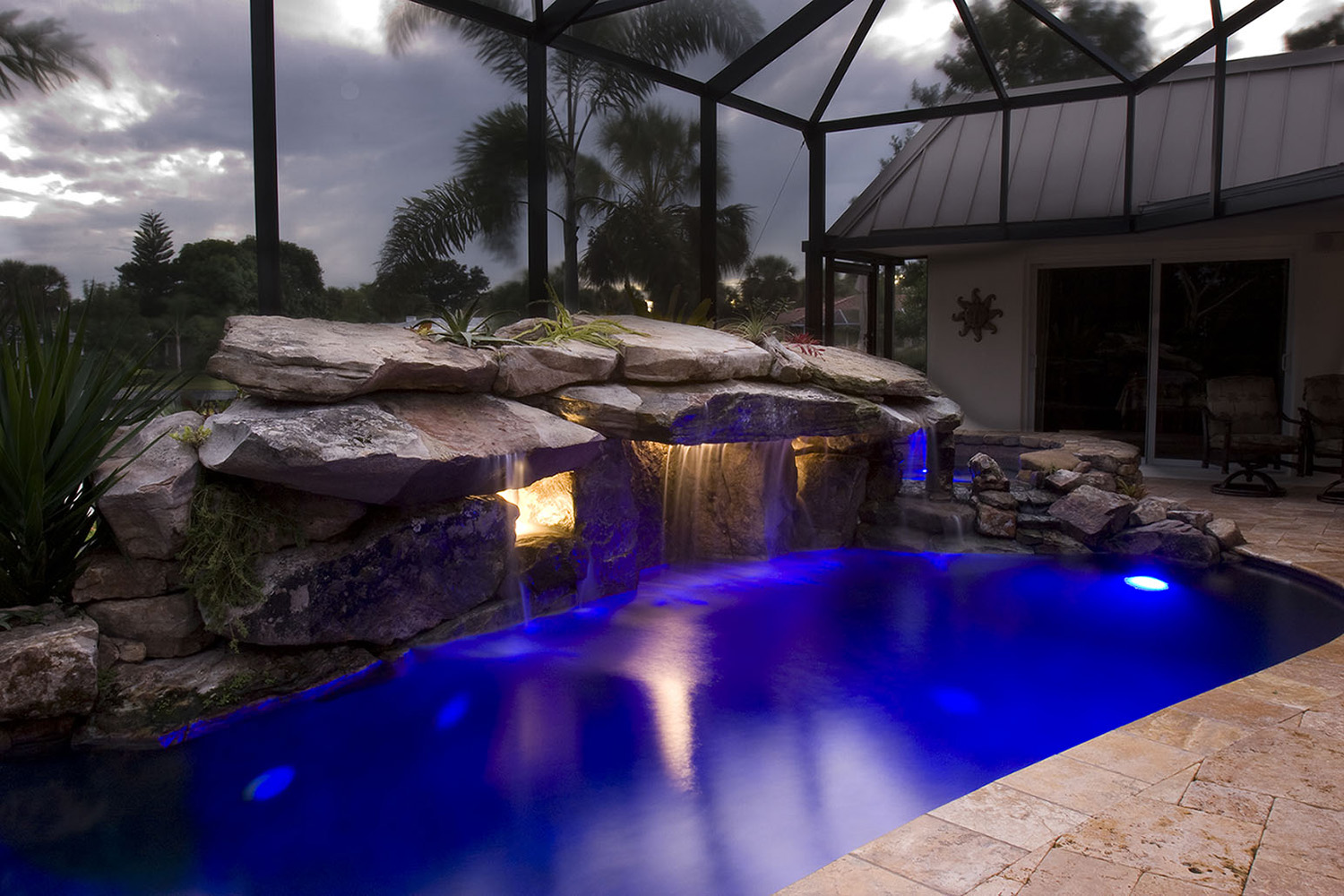 pool remodel with underwater lighting for grotto waterfall