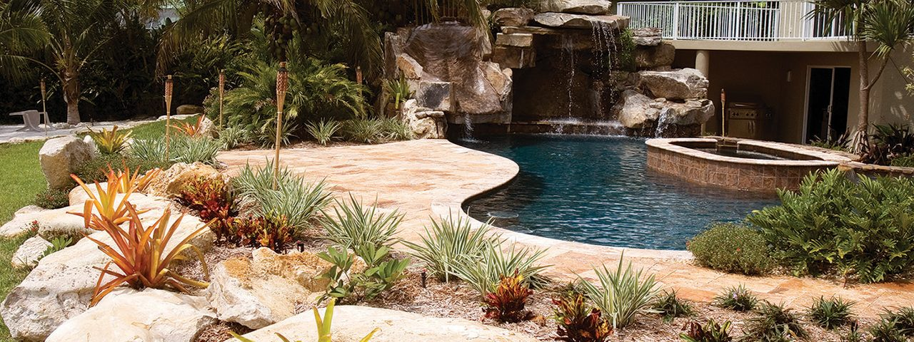 Custom Swimming Pool with Natural Stone Waterfalls and Pool ...