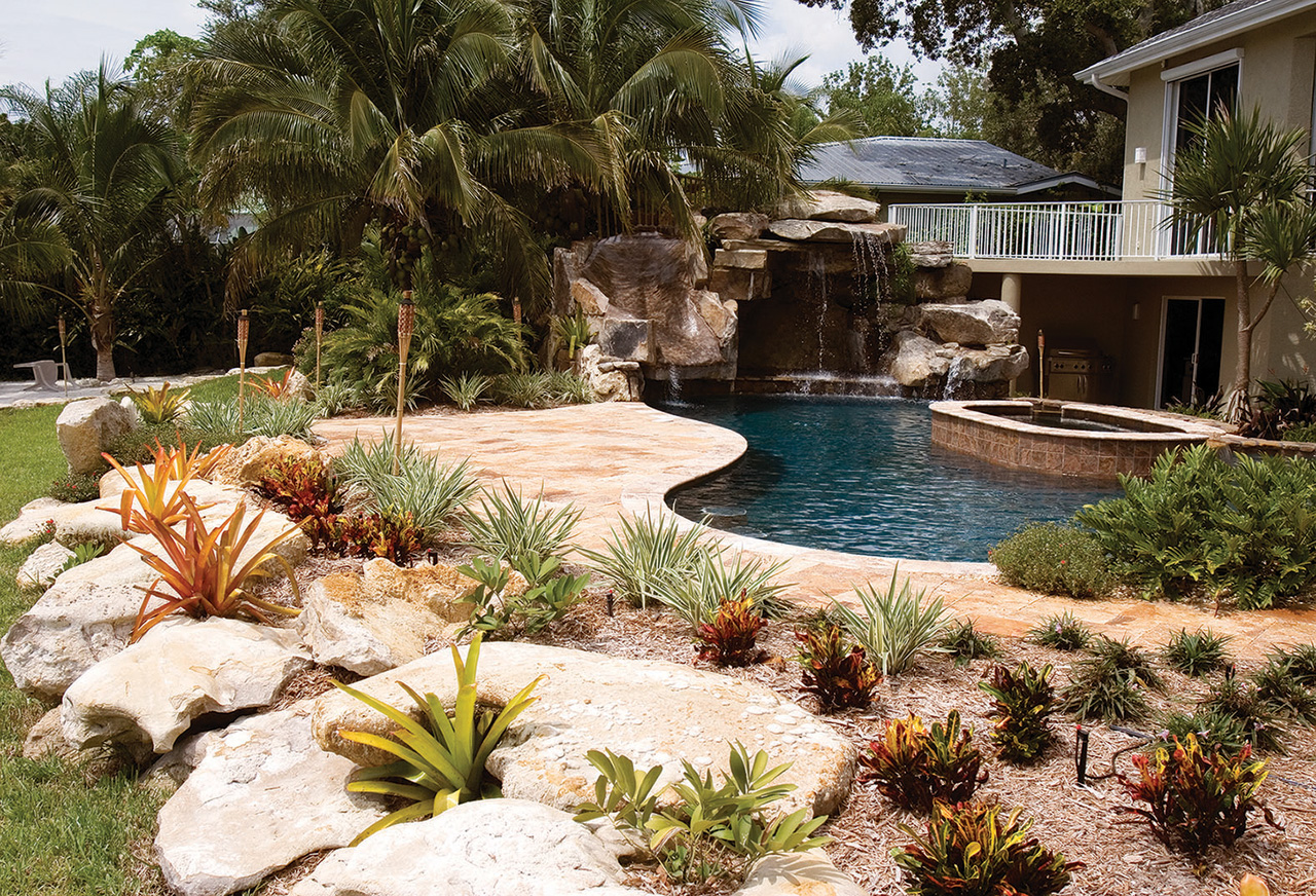 Custom swimming pool with natural stone waterfalls and - Lucas lagoons ...