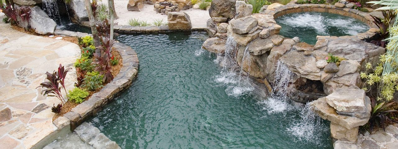 Natural Stone Grotto Waterfall with Elevated Spa Outdoor Designs
